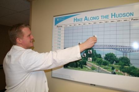 Man pointing to a graph about a Hike Along the Hudson