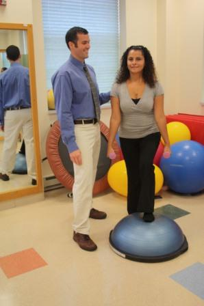 Physical therapist doing exercises with a woman